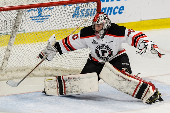 Photo: Callum Booth made 36 stops to lead the Remparts to a shutout win over the Blainville-Boisbriand Armada on December 18th.(Courtesy of Minas Panagiotakis/Getty Images)